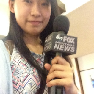 Chen Xiaoying holds the microphone during a break in the action.